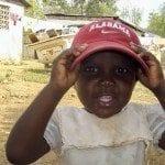 Haitian Girl wearing Alabama Crimson Tide cap Photo provided by UA