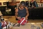 Alabama runningback Trent Richardson signing a helmet