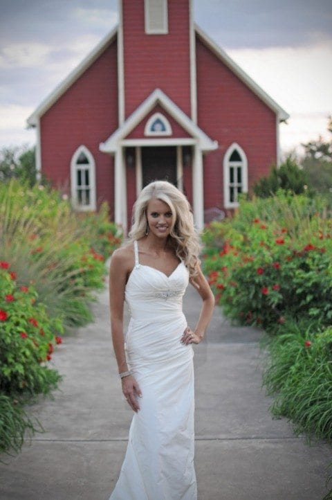 Lauren Ufer looking hot in wedding photograph outside a church.