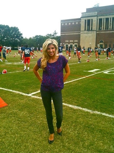 Melanie Collins at work covering football at Illinois