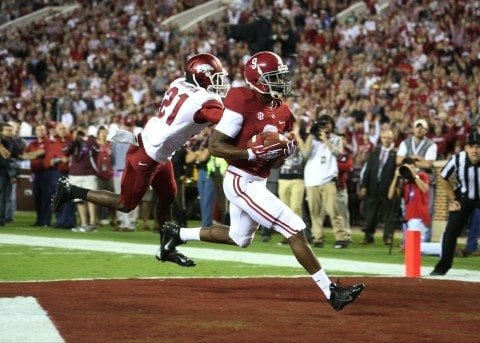 Alabama receiver Amari Cooper catches a pass for a touchdown in Alabama's win over Arkansas.