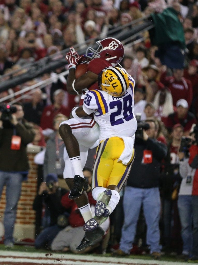 Alabama WR Kevin Norwood catches a touchdown pass from AJ McCarron in a win over LSU. Photo via Kent Gidley/UA.